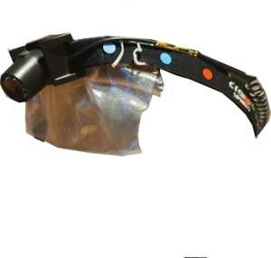 Black headlamp, with blue, green and red dots sticked to the band, and a makeshift plastic display attached.